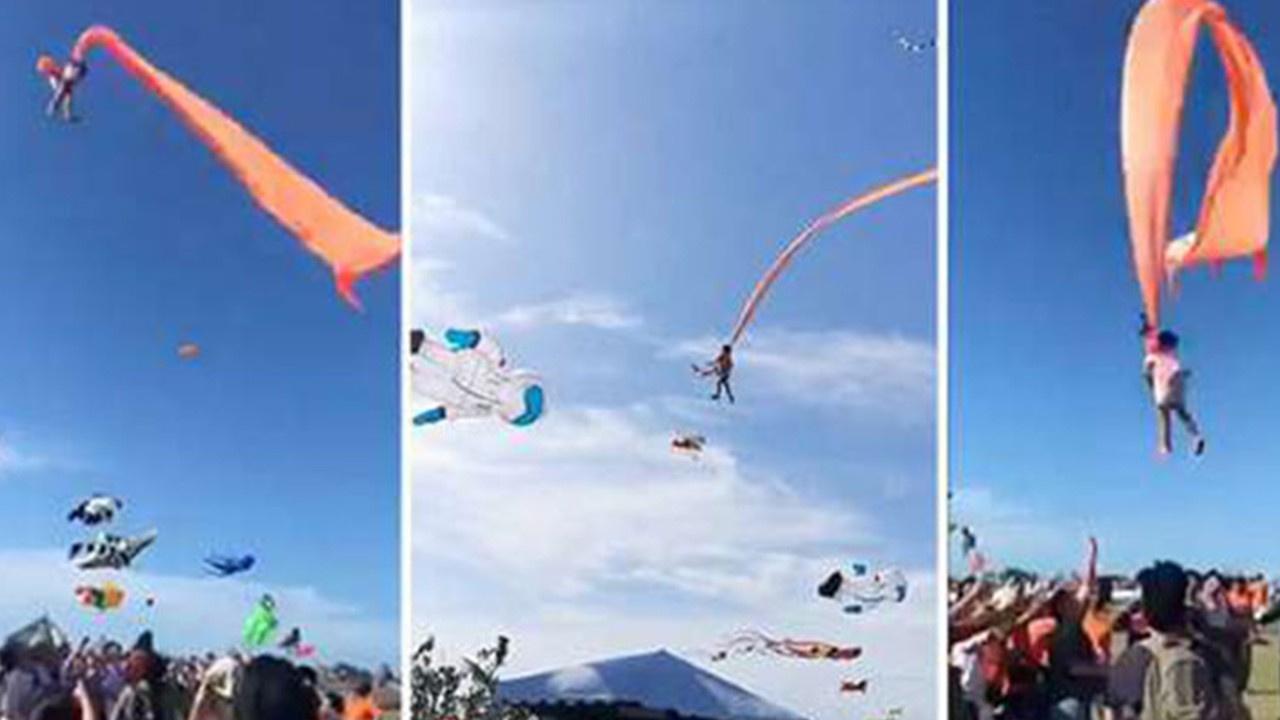 Küçük çocuk uçurtmaya tutunup havaya savruldu!