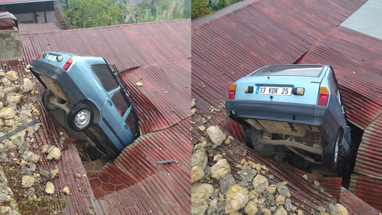 Otomobil çatıya düştü!
