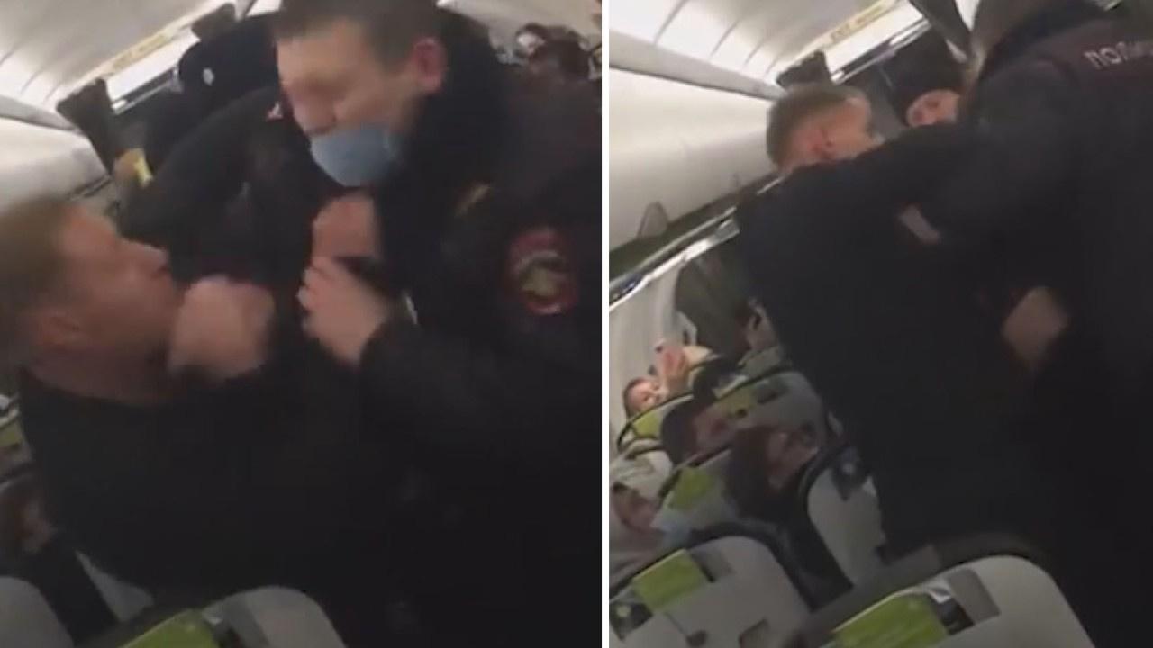 Uçakta alkollü yolcular ile polis arasında arbede