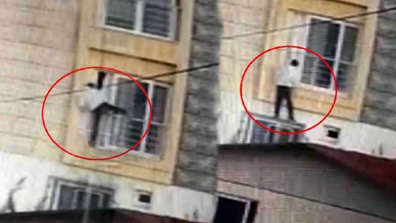 Ev sahiplerine yakalanan hırsız pencereden atladı!